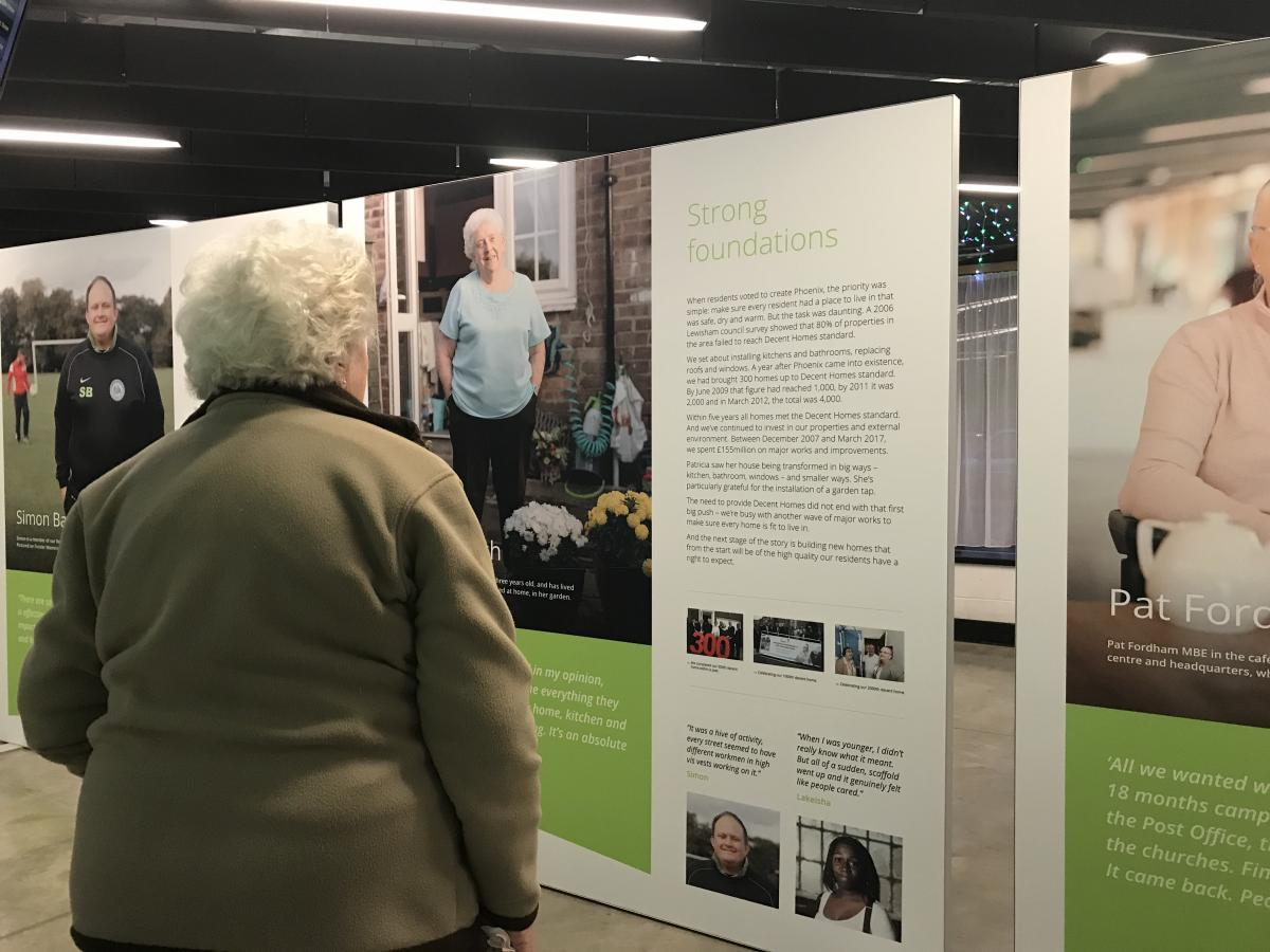 Phoenix resident Patricia Birch looking at her own picture at the exhibition