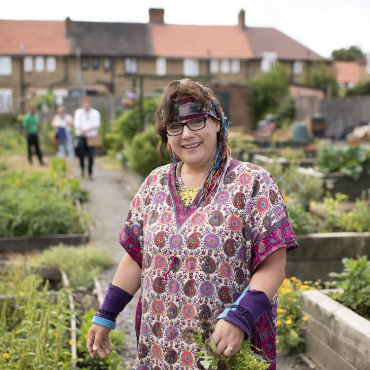 Photo of Mary Heelan at the Farmstead Road community garden, owned by Phoenix Community Housing