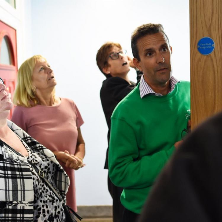 Photo of Phoenix resident scrutiny panel members Eileen and Karen and Phoenix staff Karen and James in a Phoenix block