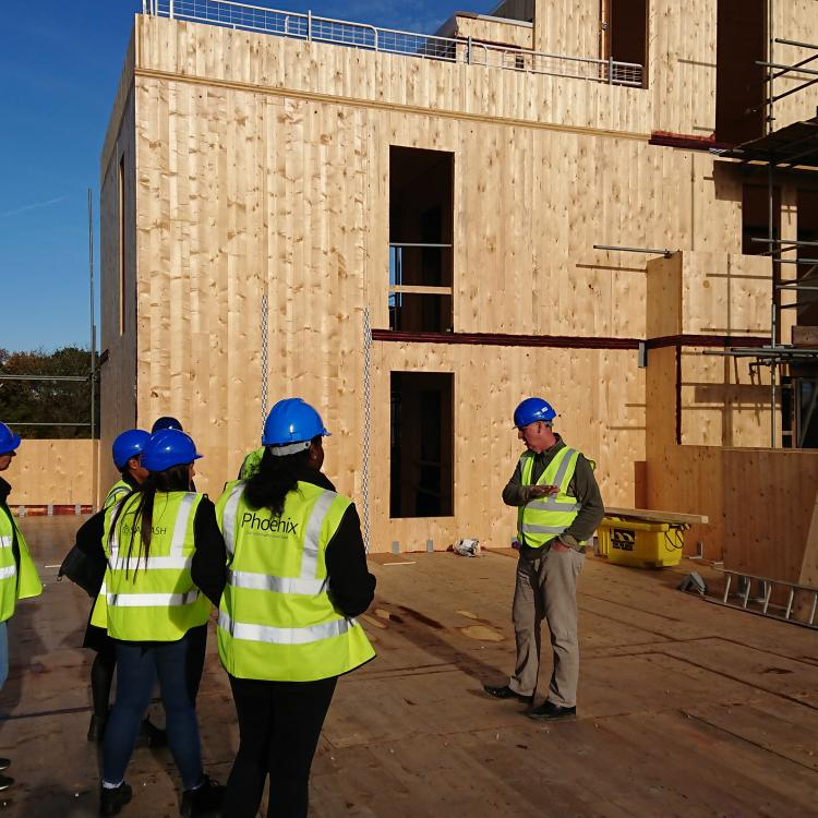 Photo of Phoenix Community Housing employees on the construction site at Nuthatch House
