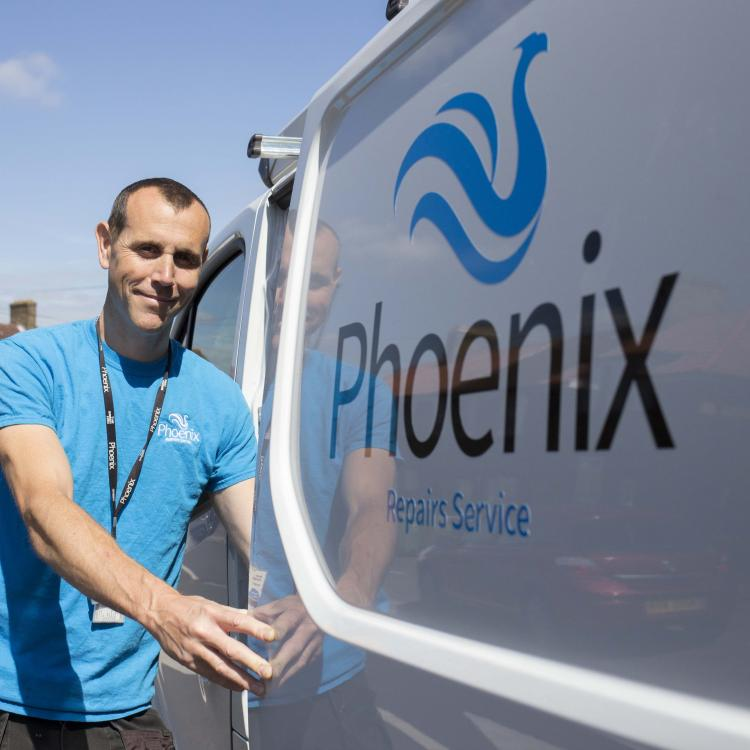 Phoenix Repairs Service staff and van