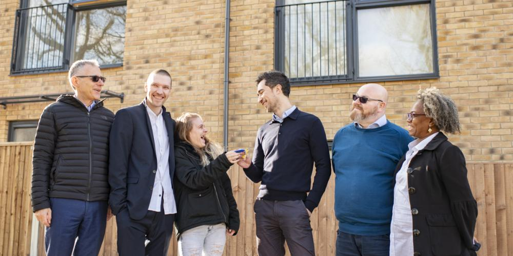 Photo of new residents of Woodbank Road, Mayor of Lewisham Damien Egan, Cllr Paul Bell, and Phoenix Community Housing Chief Executive and Vice Chair