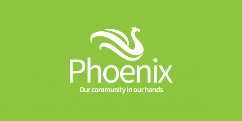 Phoenix Community Housing logo on green background
