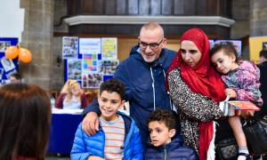 Photo of a family finding out about Community Chest projects