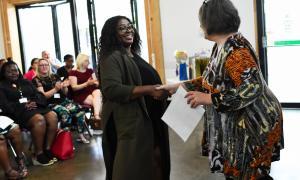 Photo of a 2018 participant graduating