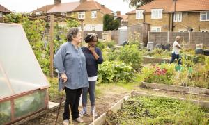 Photo of Anne McGurk and Carmen Simpson at the Farmstead Road Community Garden