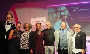 Photo of Phoenix Community Housing residents and staff accepting the Best Training Scheme award for the Phoenix Academy at the 24housing Awards