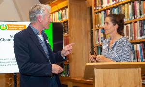 Photo of John Thompson talking to Emma Weston OBE, Chief Executive of Digital Unite