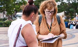 Photo of a Phoenix staff member doing consultation work at a Summer Fun event